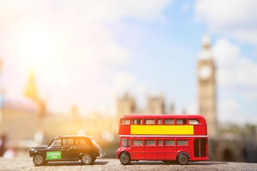 Close-up view of public transport figurines with Big Ben in the background