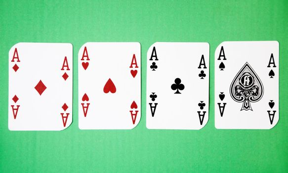 Four Aces against green background