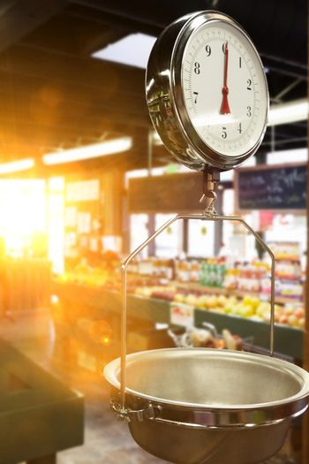 Weighing scales in supermarket with lens flare