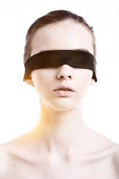 Caucasian woman wearing blindfold