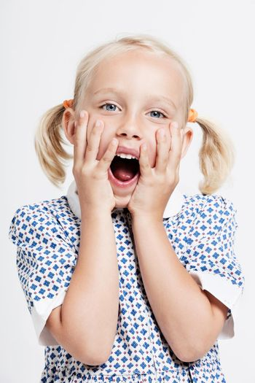 Shocked little blonde girl