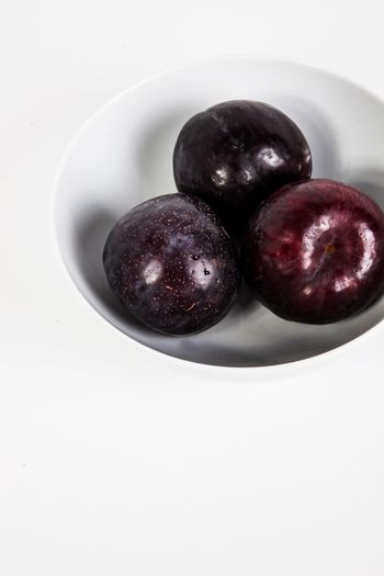 Plums in bowl