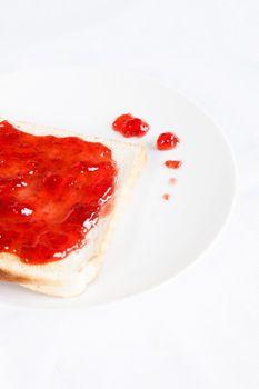 Strawberry jam jelly on toast