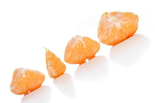 Close - up of mandarins on white background
