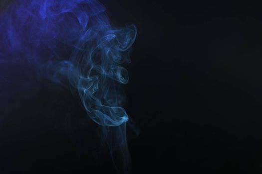 Movement color smoke girl black background with copy space.