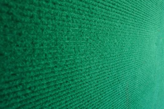 Velvet fabric wall with green background selective focus.