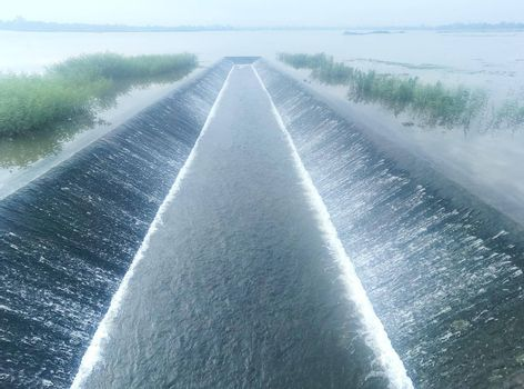 The amount of water in irrigation during the rainy season