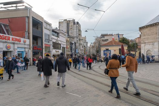 a wide angle of Istiklal Street in Taksim and tram way on the entrance of street