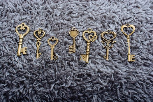 Set of small decorative keys on fabric