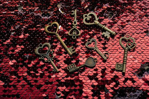 Heart shaped retro metal keys on bright background