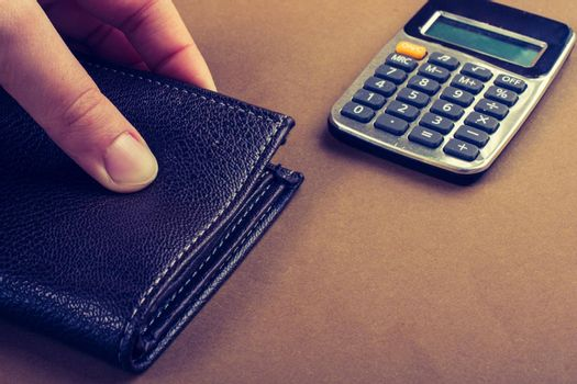 Calculator and wallet in hand  saving and finance concept