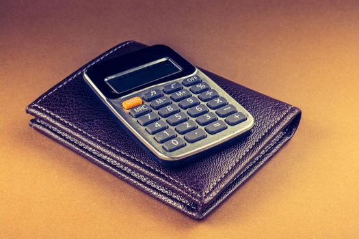 Calculator and wallet as  saving and finance concept