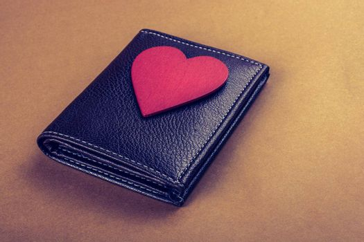 Red heart and wallet in hand  saving and finance concept