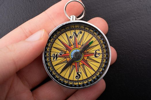 Compass in hand  as symbol of tourism and outdoor activities with compass