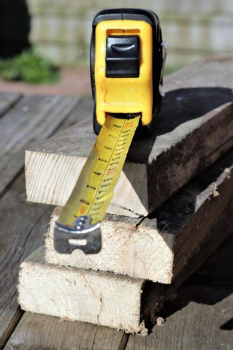 Measure resting on sawn wood