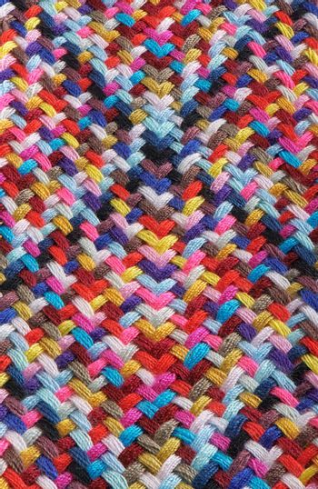 A braid of multi colored sewing threads, photo stacking