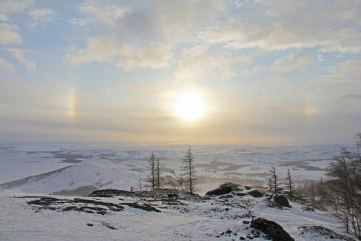 Halo effect and winter landscape