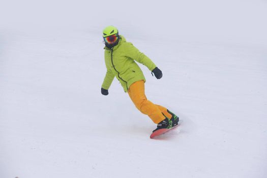 Woman snowboarder on slope