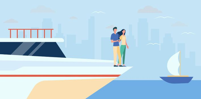 Happy couple standing on edge of yacht