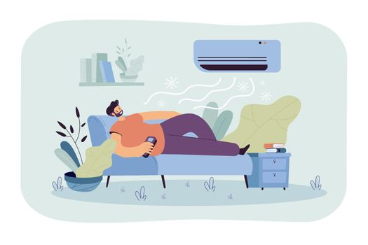 Man relaxing on couch under cold air flow