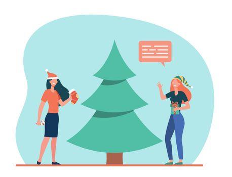 Happy girls decorating Christmas tree