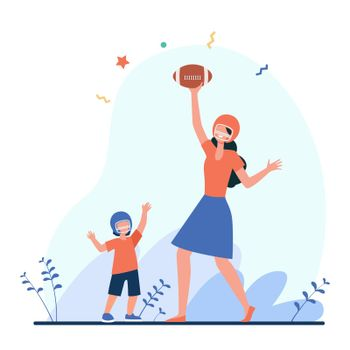 Mom and son playing football