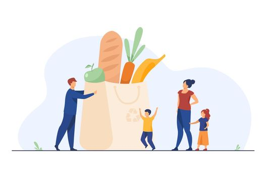 Tiny family at grocery bag with healthy food