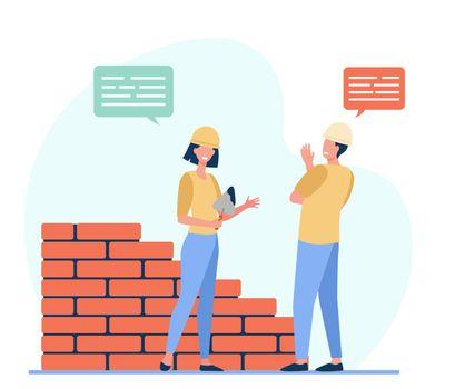 Two positive builders talking and working