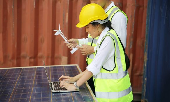 technicians install panels Solar cells to produce and distribute electricity. Energy technology concept