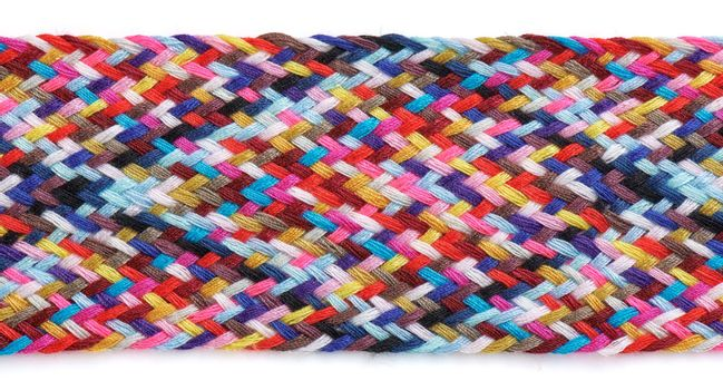 A braid of multi colored sewing threads on a white background