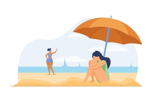 Depressed woman on sea beach