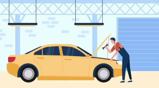 Mechanic repairing car in garage with tool