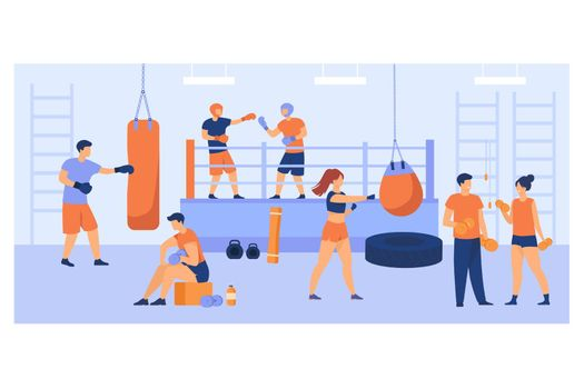 Men and women training in boxing club