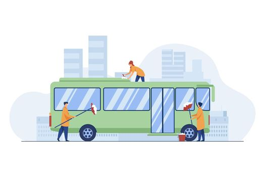 Workers cleaning and washing bus