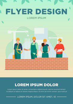 Professional builders making brick wall