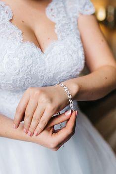 the bride wears a wedding bracelet on her left hand