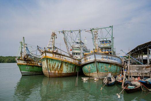 Koh Phitak , Chumphon province Thailand January 2020, fishing boats and small huts above the water, Koh Phitak a tradiional fishing village in Thailand Asia