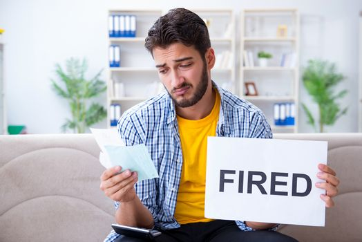 Unemployed man frustrated at bills he needs to pay