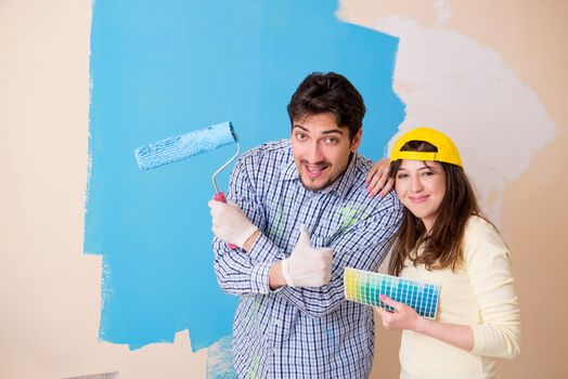 Husband and wife doing renovation at home