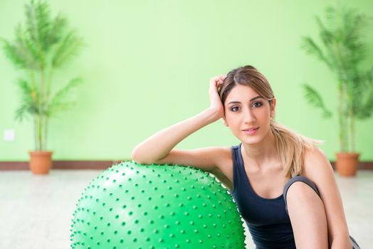 Woman doing exercises with swiss ball