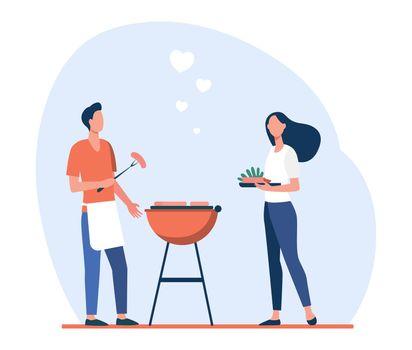 Loving man and woman doing backyard barbecue