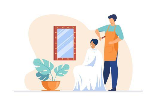 Male hairdresser brushing hair of woman