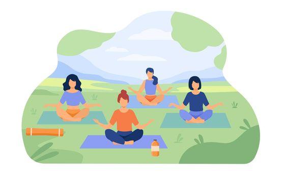 People enjoying outdoor yoga class in park