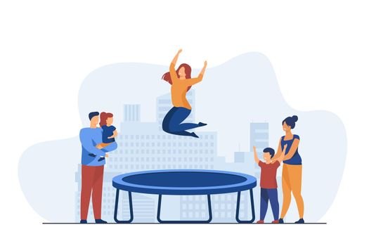 People looking at woman jumping on trampoline.