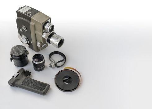 Vintage 8mm camera with 8mm reel and accessories.