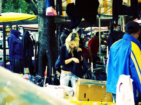 Woman shopping at marketplace in Turin