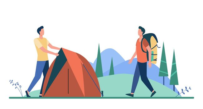 Two tourists pitching tent on meadow
