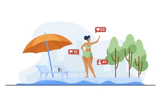 Woman taking selfie near outdoor swimming pool