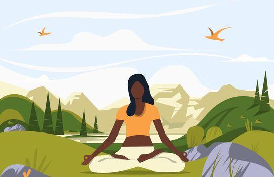 Woman sitting in lotus pose outdoors