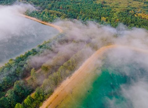 Morning fog over the lake aerial view of mist fog landscape autumn in the forest
